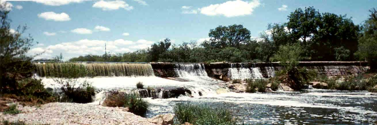 Picture of water flowing over dam on the Concho River at Double M Boer Goats.